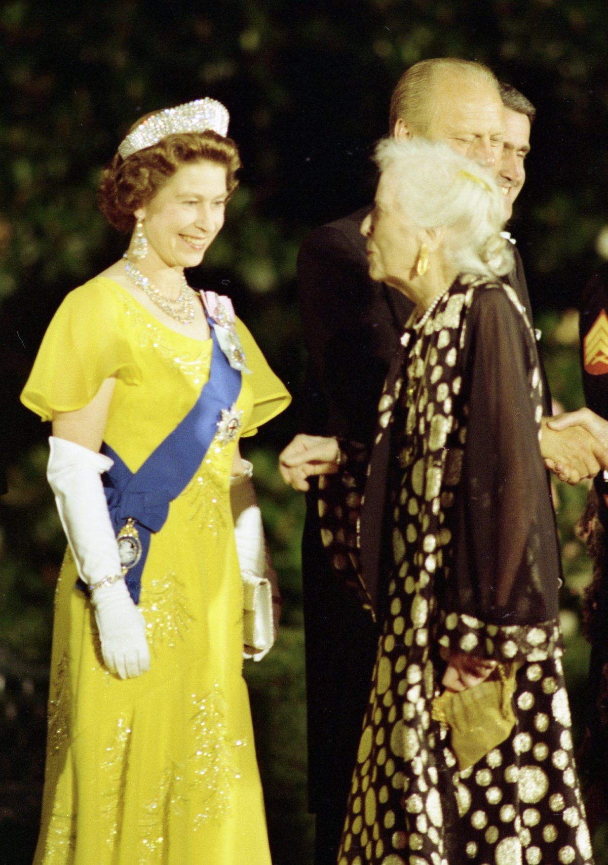 Queen Elizabeth II of Great Britain Greeting Alice Roosevelt Longworth, Daughter of President Theodore Roosevelt, in the Receiving Line on the South Driveway of the White House Prior to a State Dinner Honoring Her Majesty and Prince Philip