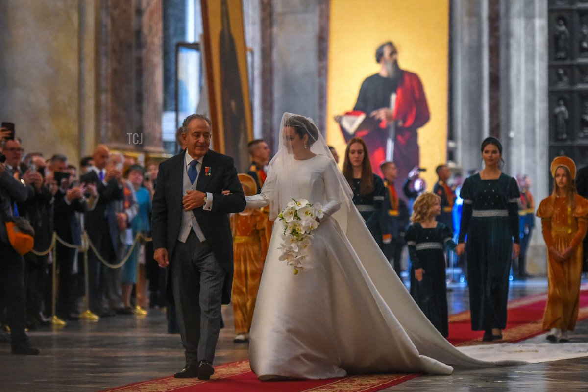Victoria Romanovna Bettarini accompanied by her father, Roberto Bettarini arrive for her wedding ceremony at Saint Isaac's Cathedral in Saint Petersburg, on October 1, 2021