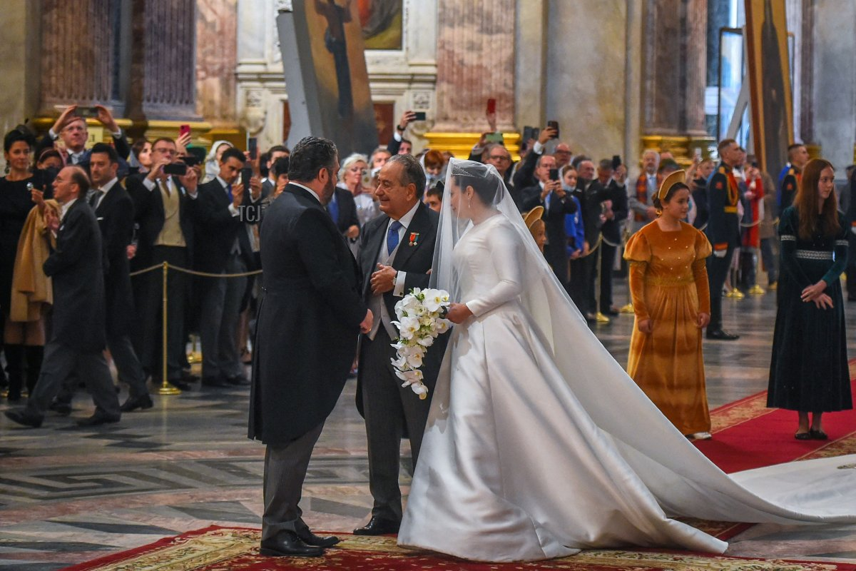 Grand Duke George Mikhailovich Romanov (L) welcomes Victoria Romanovna Bettarini accompanied by her father, Roberto Bettarini, as they arrive for the wedding ceremony at Saint Isaac's Cathedral in Saint Petersburg, on October 1, 2021