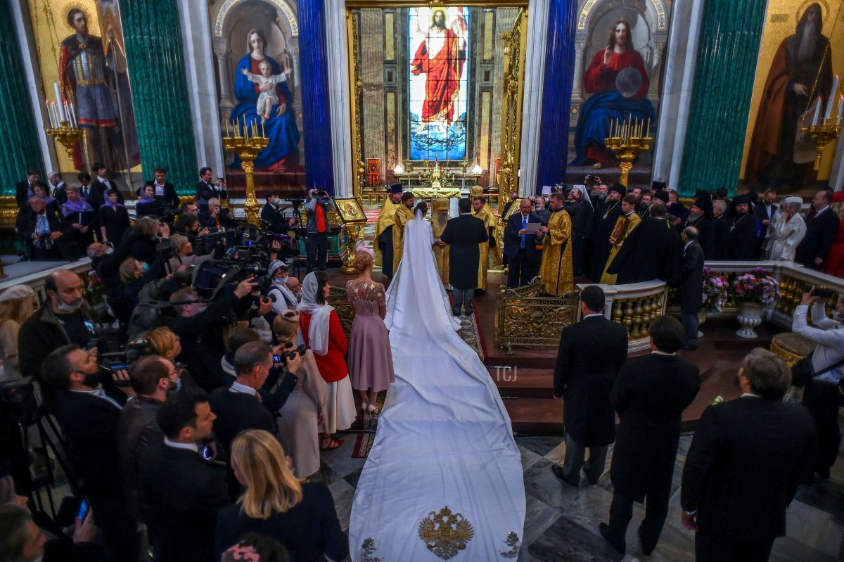 Grand Duke George Mikhailovich Romanov and Victoria Romanovna Bettarini attend their wedding ceremony at Saint Isaac's Cathedral in Saint Petersburg, on October 1, 2021