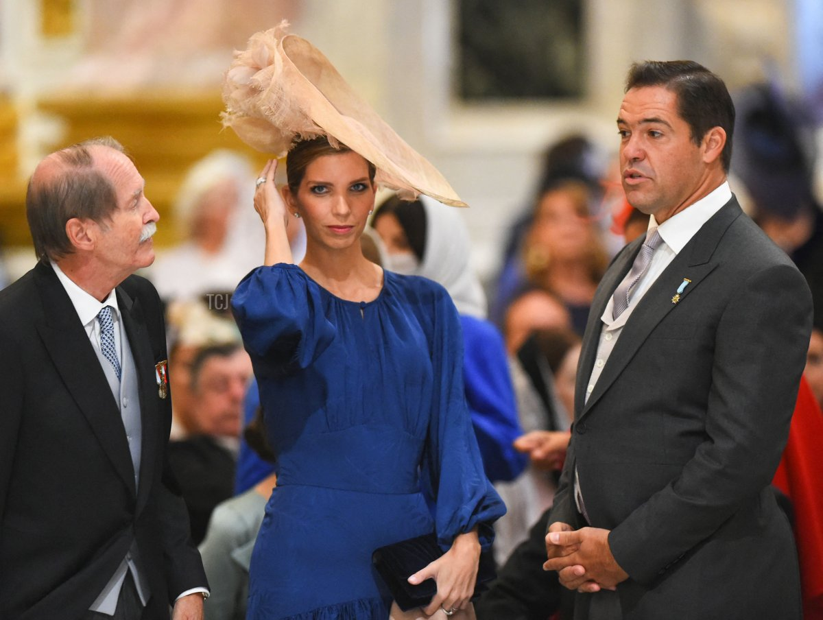 Duke of Braganza Duarte Pio (L) speaks with Princess Marie-Marguerite, Duchess of Anjou (C), and her husband Prince Louis Alphonse de Bourbon, Duke of Anjou (R), as they attend the wedding ceremony of Grand Duke George Mikhailovich Romanov and Victoria Romanovna Bettarini at Saint Isaac's Cathedral in Saint Petersburg, on October 1, 2021