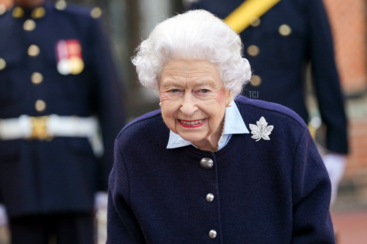 Britain's Queen Elizabeth II gestures as she meets members of the Royal Regiment of Canadian Artillery to mark the 150th Anniversary of the foundation of A and B Batteries, at Windsor Castle, Windsor on October 6, 2021