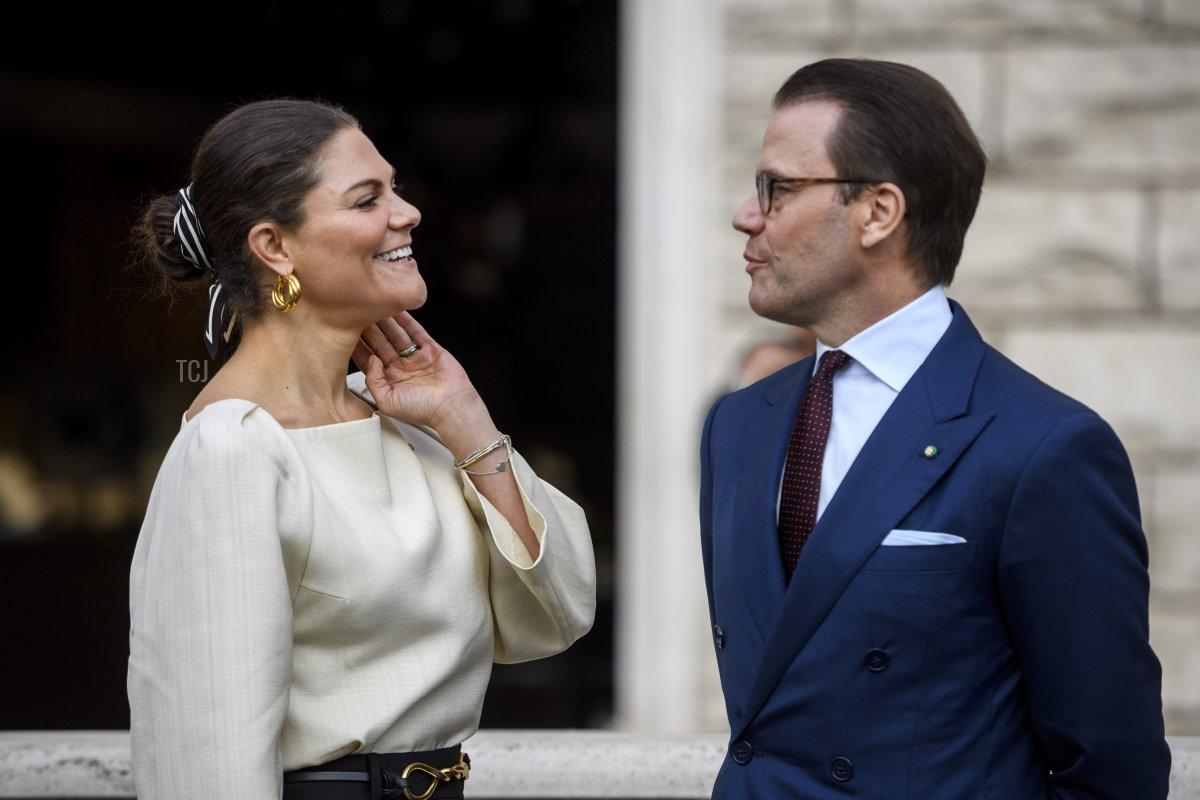 """Prince Daniel of Sweden and Crown Princess Victoria of Sweden visit the inauguration of the """"Images that change the world"""" exhibition at Piazza San Silvestro, during a two-day visit in Rome to promote bilateral relations in the fields of trade and investment, on October 18, 2021 in Rome, Italy"""