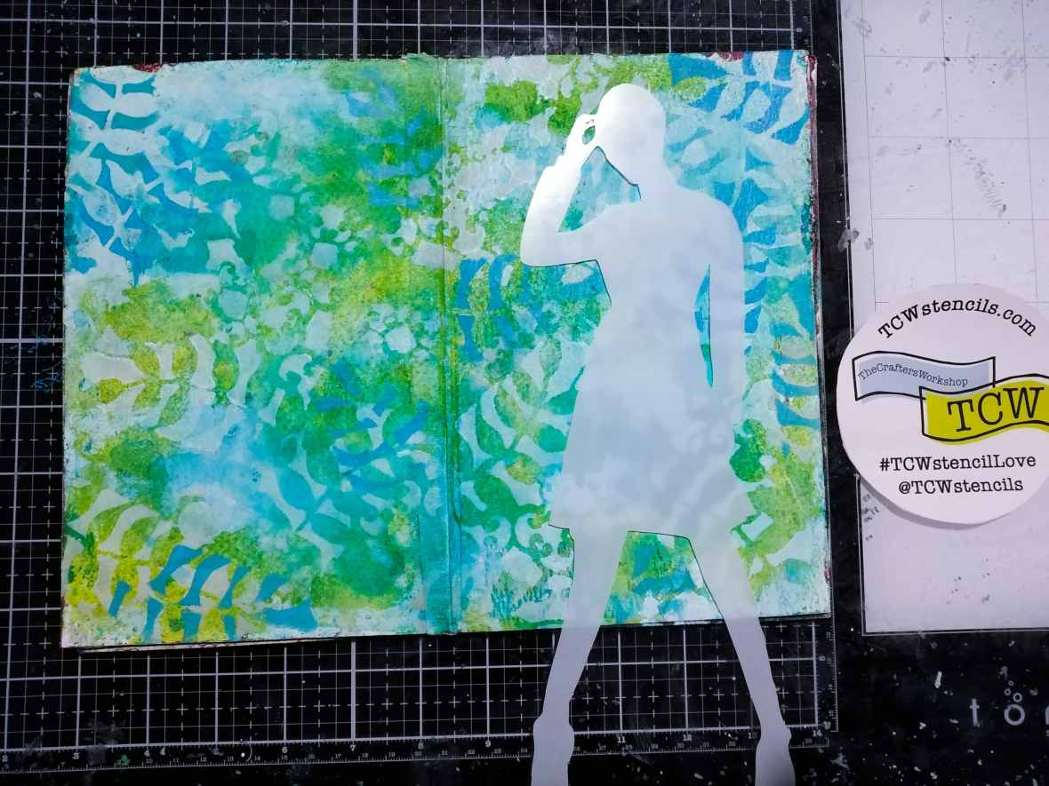 Art journal background, applied acrylic paints around a silhouette mask.