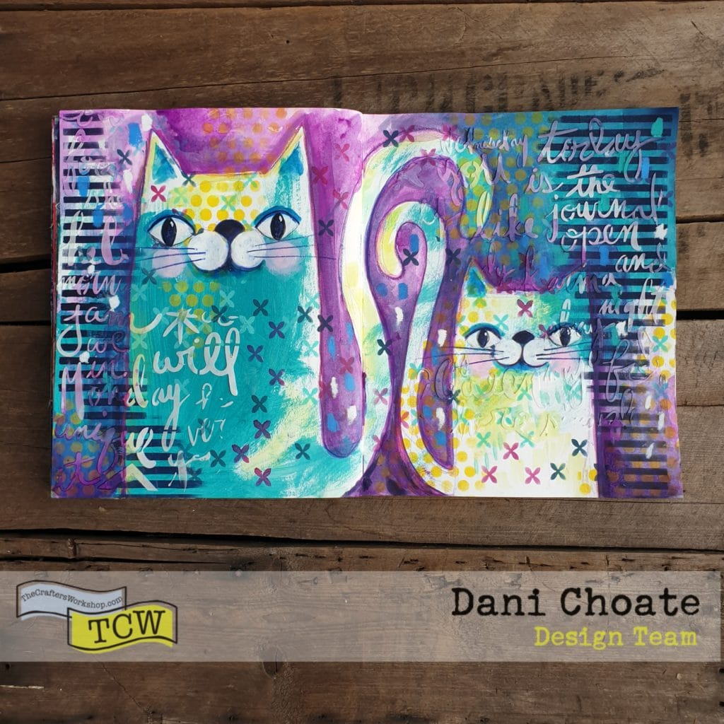 Two cats on an art journal page in purples and greens