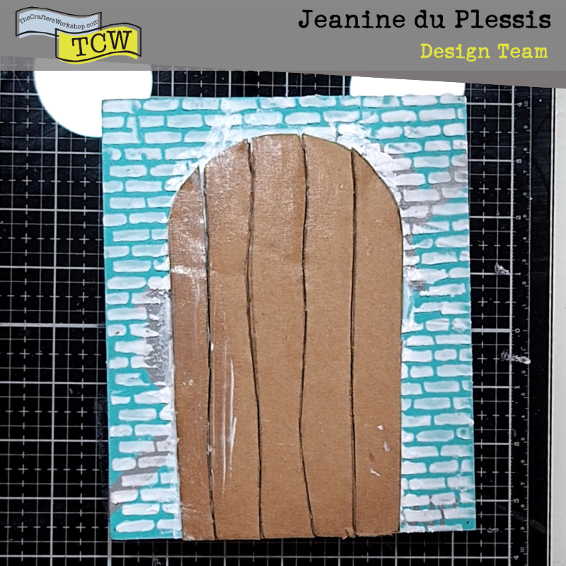 Cut out door stuck to brick pattern canvas.