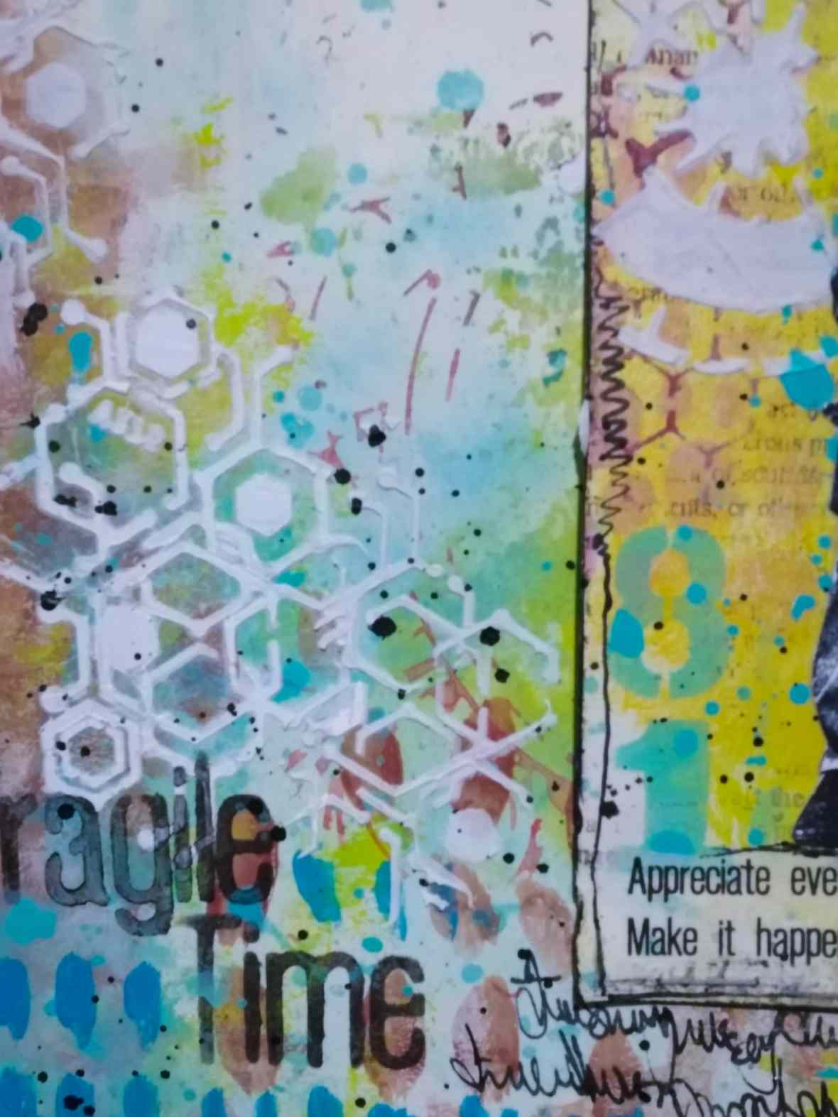 A mixed media journal spread with tcw stencils and modeling paste