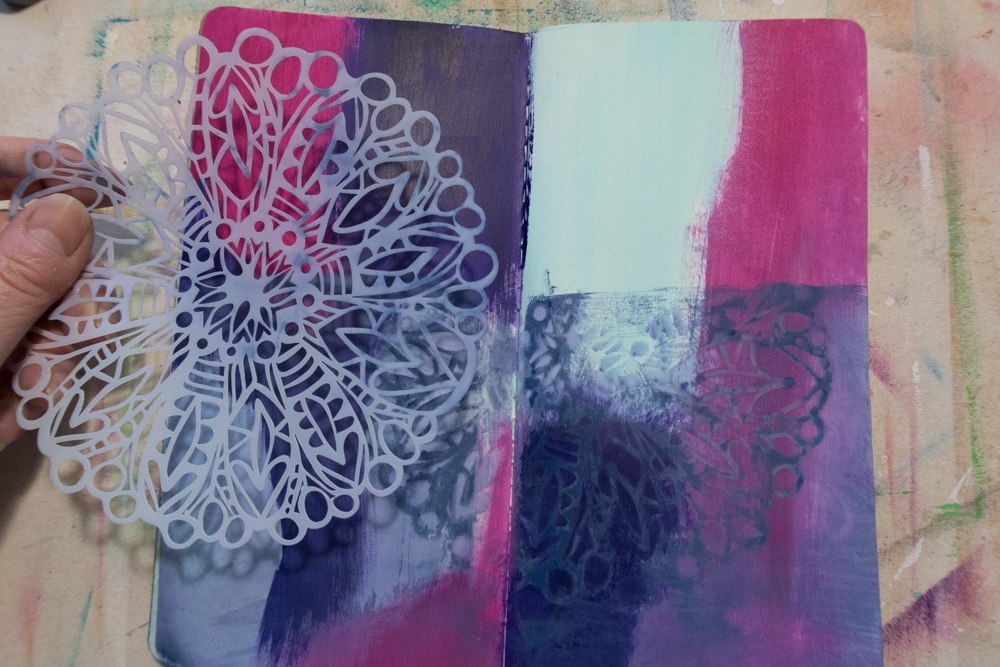 Place stencil over ink and pull back colour using baby wipe