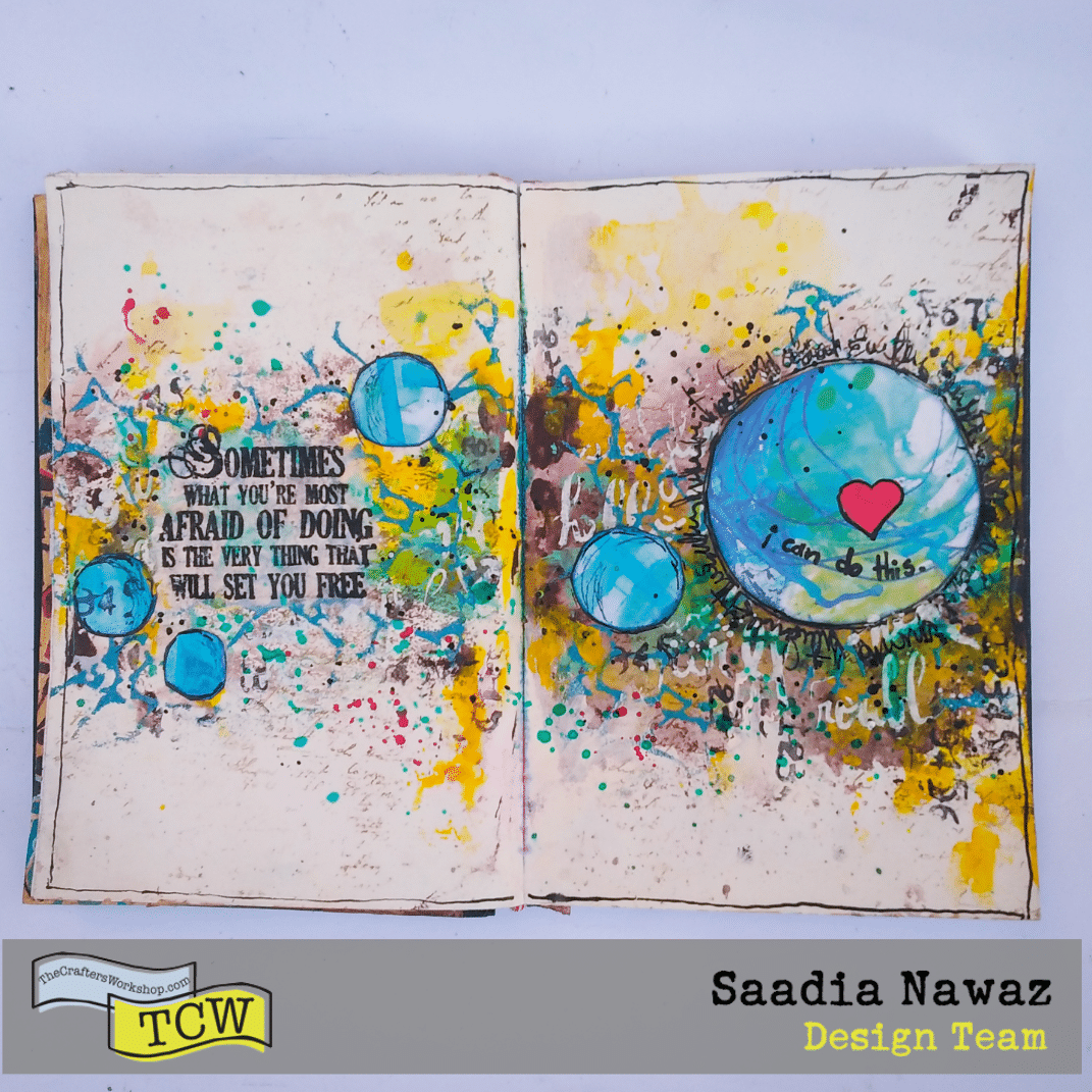 A mixed media art journal spread with stencils, acrylic paints, modeling pastes, inks and embossing