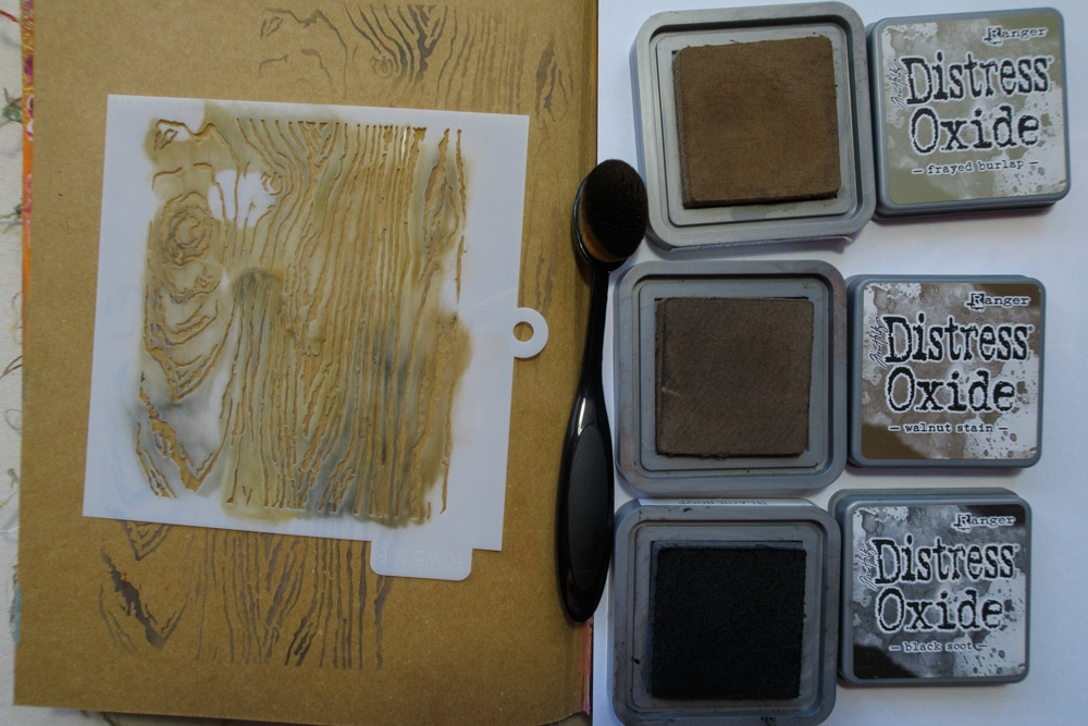 Inking with TCW5006 Woodgrain and Distress Oxide inks in brown and black for background.