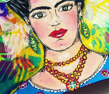 close up image of Frida Kahlo's painted face