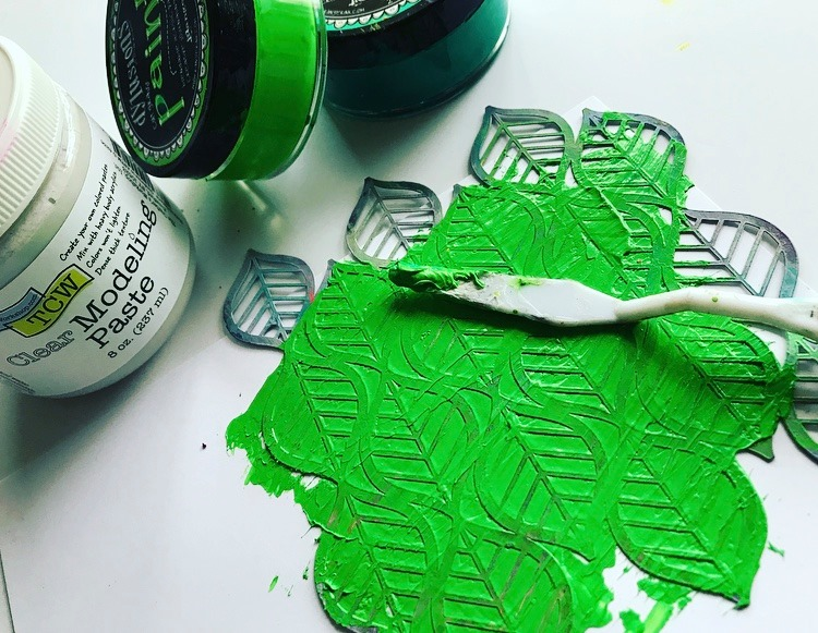 Bright green paint added to clear modeling paste being swiped over The Crafters Workshop Deco Leaves Stencil #tcwstencillove