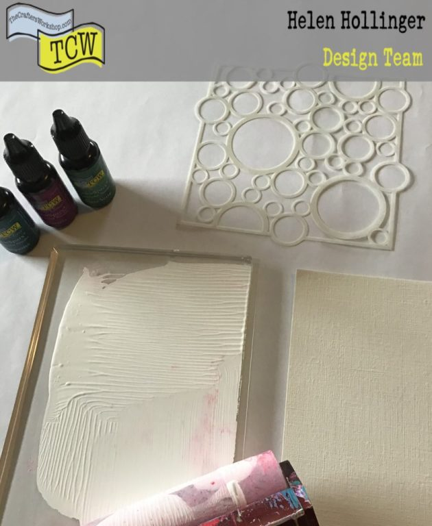 Adding white acrylic paint to gel press and placing stencil on it.