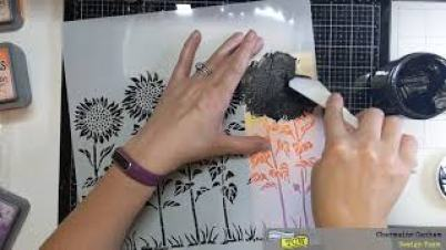 Apply Black Modeling paste over Sunflower Meadow 12x12 stencil with palette knife