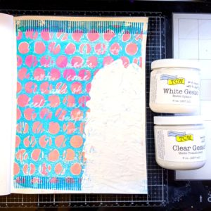 Cover the deli paper with TCW  Clear Matte Gesso to adhere to the page then use TCW White Gesso to prepare the spot for the stamp