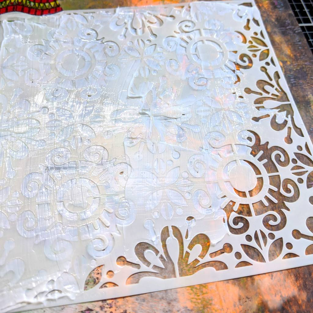 Lightly apply the gel with a palette knife all over the stencil