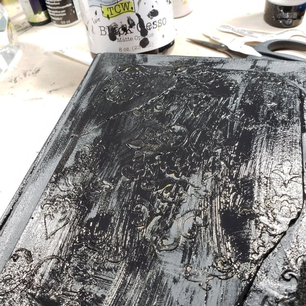Covered the gold modeling paste with black gesso