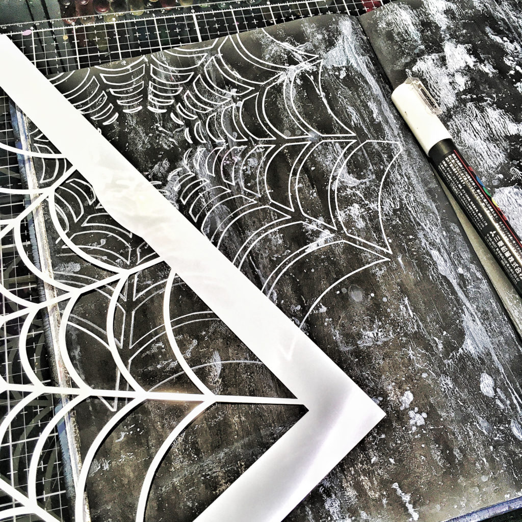 TCW877 Spider's Web Stencil drawn with white paint marker.