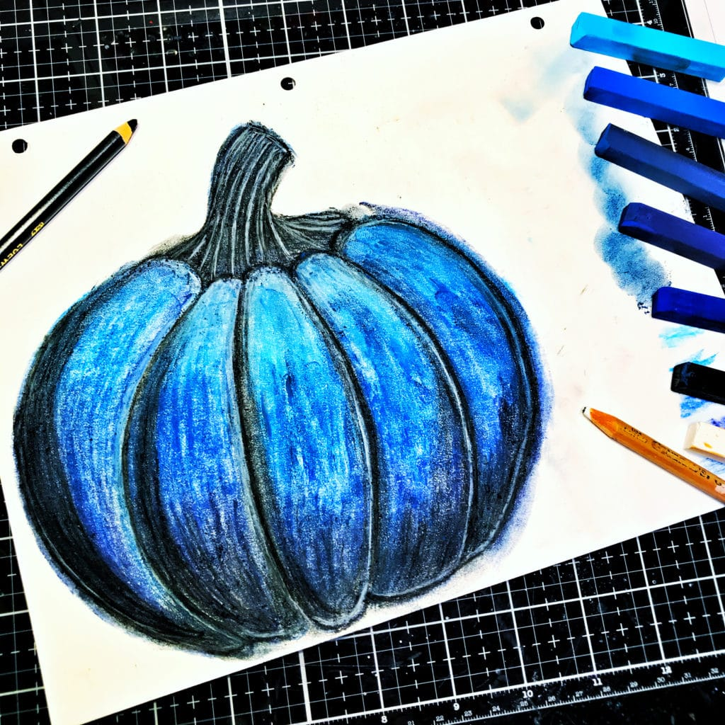 Blue chalk pastels through 12x12 TCW878 Jack-O-Lantern Stencil; details with black and white charcoal pencils