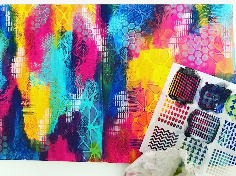 adding mark making using TCW stencils to a rainbow background #tcwstencillove