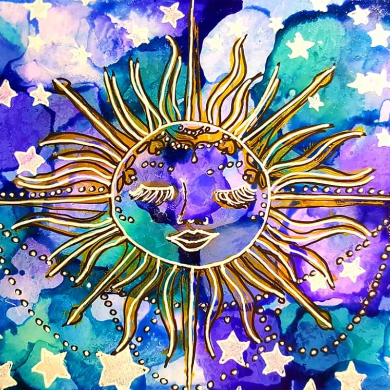 Yupo paper with bleu, purple, and turquoise alcohol inks beneath the Celestial sun and Star shower stencils traced with black, white, and gold Signo uni-ball pens.