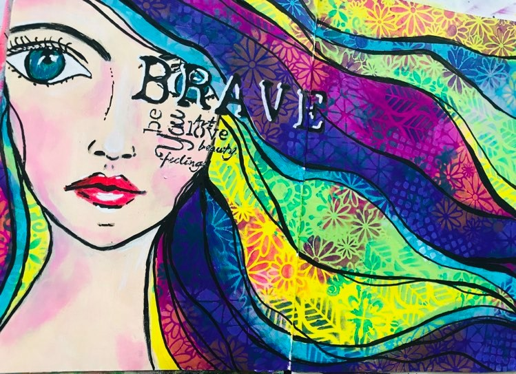 Art Journal page with a girl with flowing rainbow stenciled hair and inspiring words over her face including Brave, you, art, love, beauty, be, feelings #tcwstencillove
