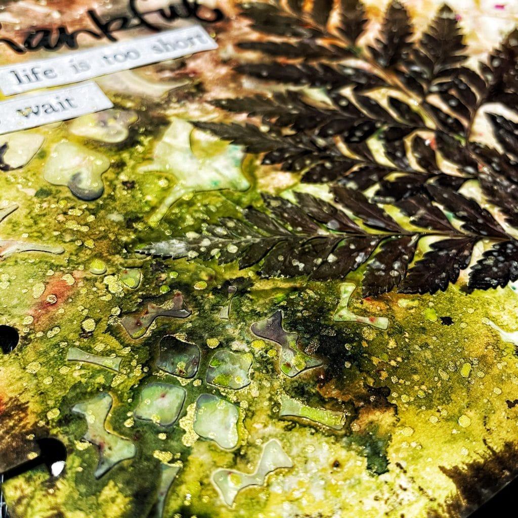 Close up of Acrylic Gold Paint Splashes