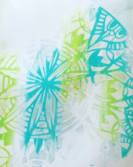 blue and green mandala pattern in background of art journal