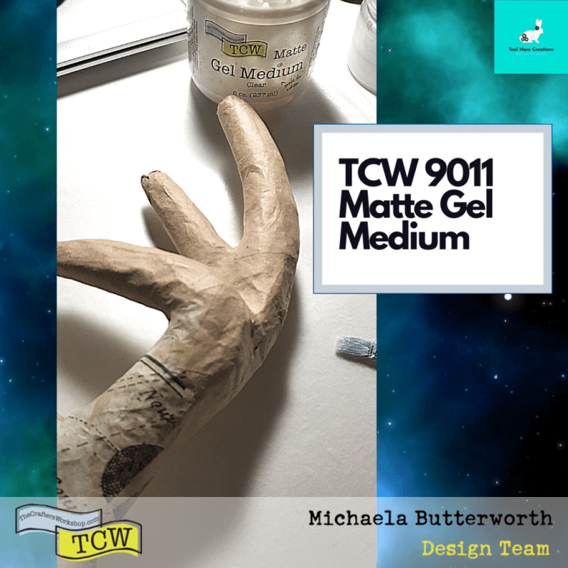 Close up image showing the papier mache antler being covered with TCW9011 Matte Gel Medium and tissue paper.