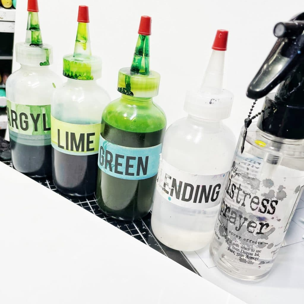 Homemade green alcohol inks, blending solution, and alcohol. Paper: high gloss photo paper.