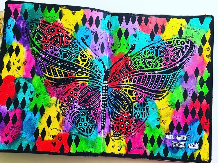 Art journal page - bright shimmery background and large black butterfly in centre with doodling #tcwstencillove Tammy Klingner