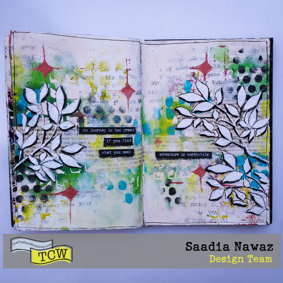 A mixed media art journal spread with The Crafters Workshop stencils, acrylic paints, and mediums