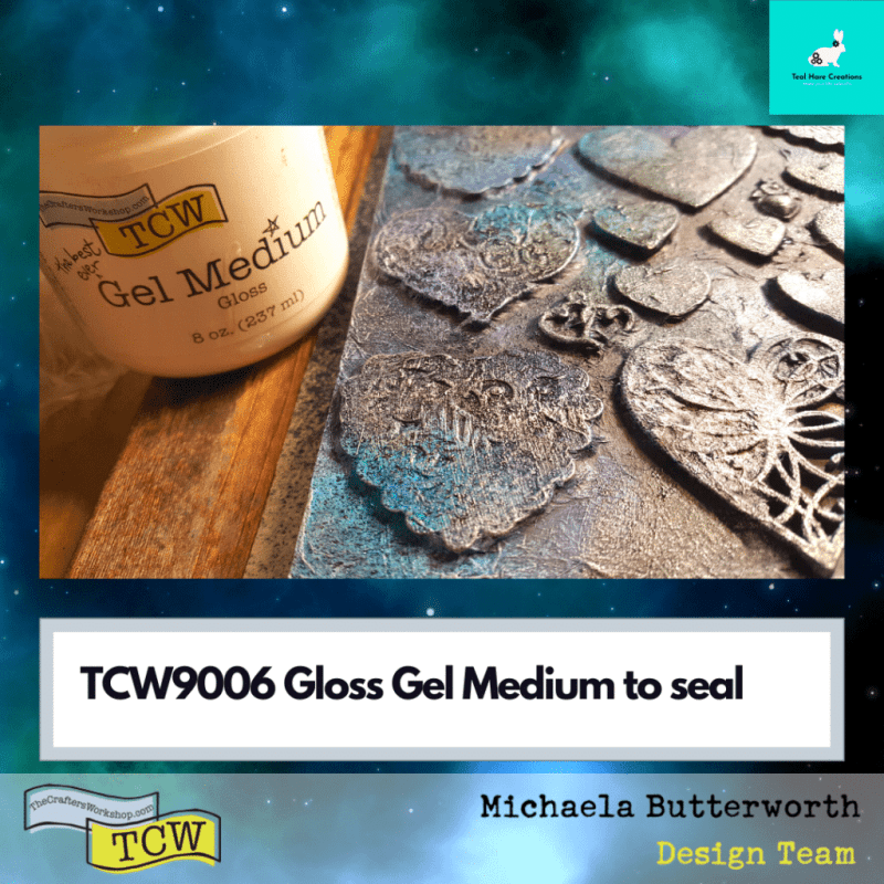 Gloss gel medium jar is shown next to the wood panel. The gel has been applied to the embellishments.