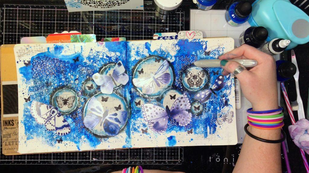 white metallic watercolor cream over modeling paste dots