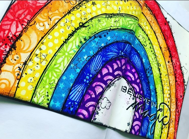 art journal page rainbow titled believe in magic