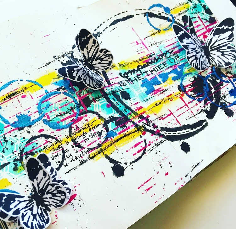 completed art journal page with circles, butterflies and pops of color