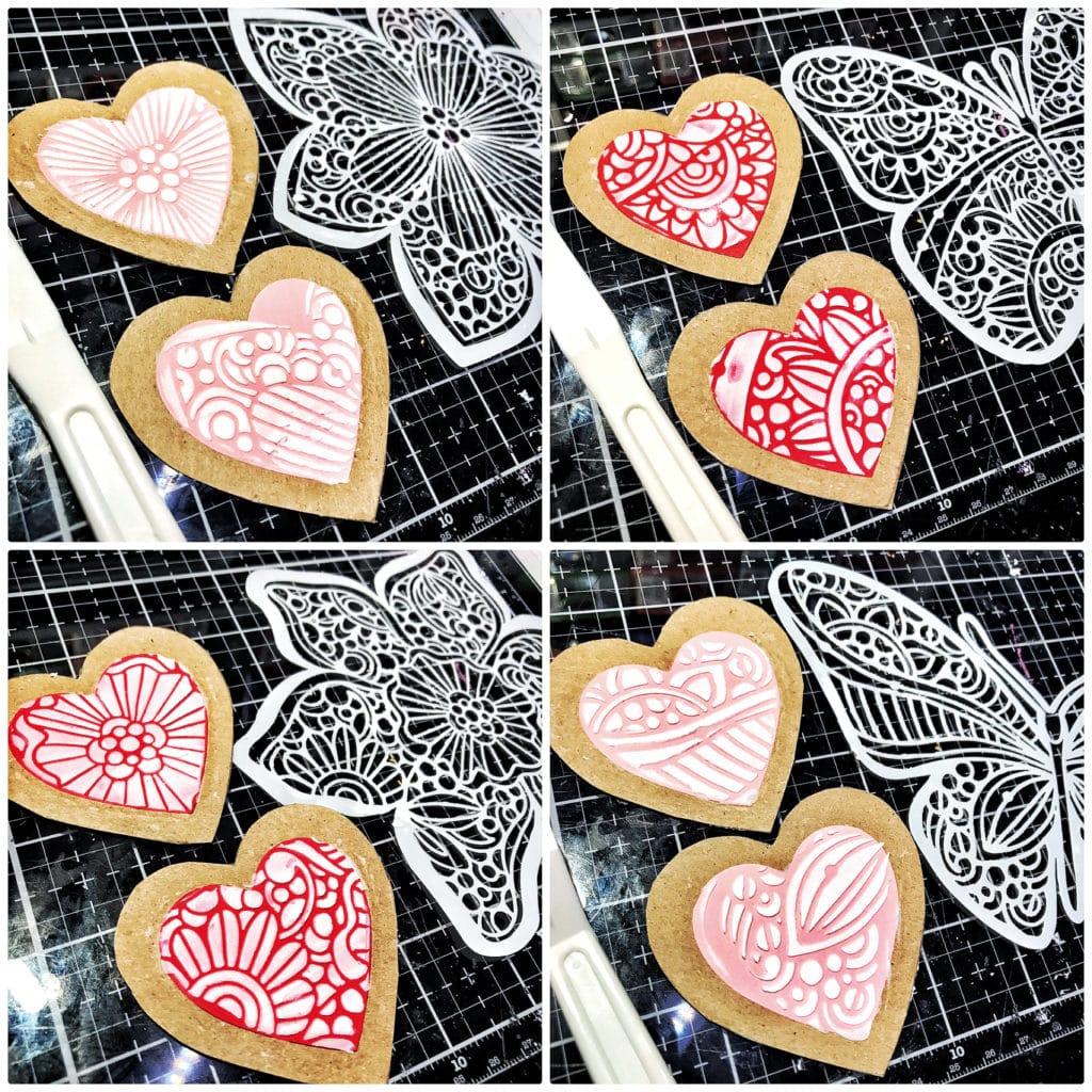 TCW9004 Light and Fluffy Modeling Paste through TCW931 Collarette Dahlia, TCW934 Sunny Butterfly, TCW928 Trumpet Daffodil, TCW933 Joyous Butterfly 6x6 Stencils with a palette knife onto heart shaped paper cookies