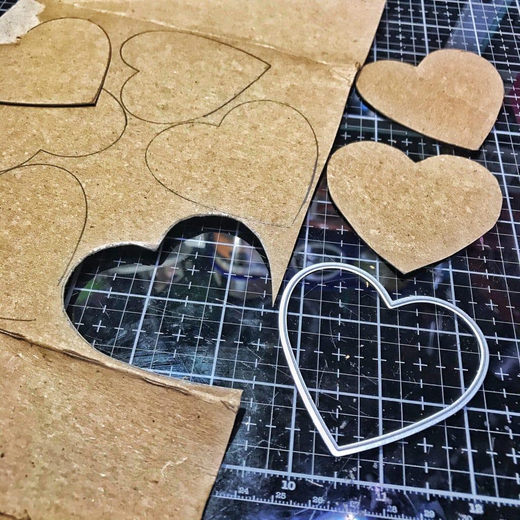 cardboard hearts cut from a heart shaped metal die
