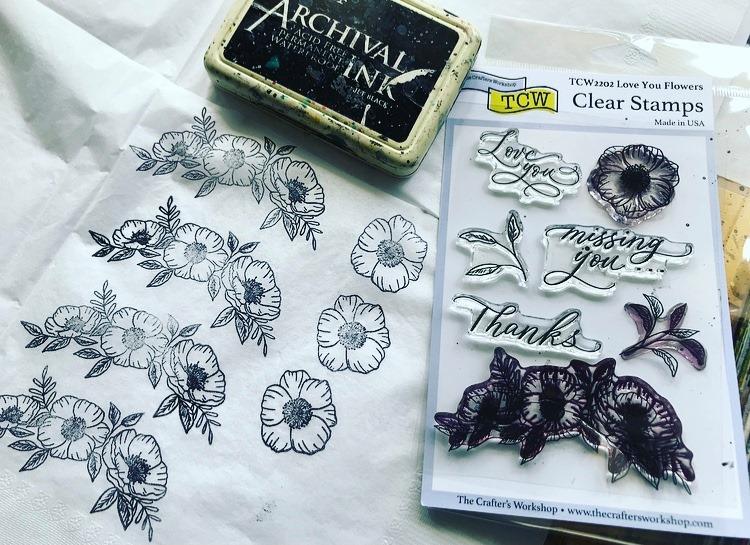 stamping flowers onto white napkins