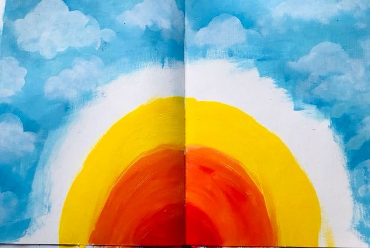 arches of red orange and yellow paint added to form the sunrise