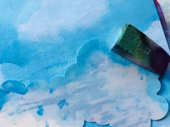 creating clouds using stencil and sponge