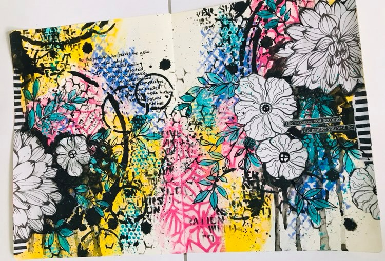 completed art journal page with flowers, drips and leaves