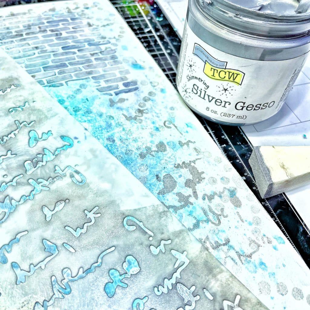 TCW9010 Silver Gesso through 12x12 TCW541 Believe Script Stencil with a cosmetic sponge