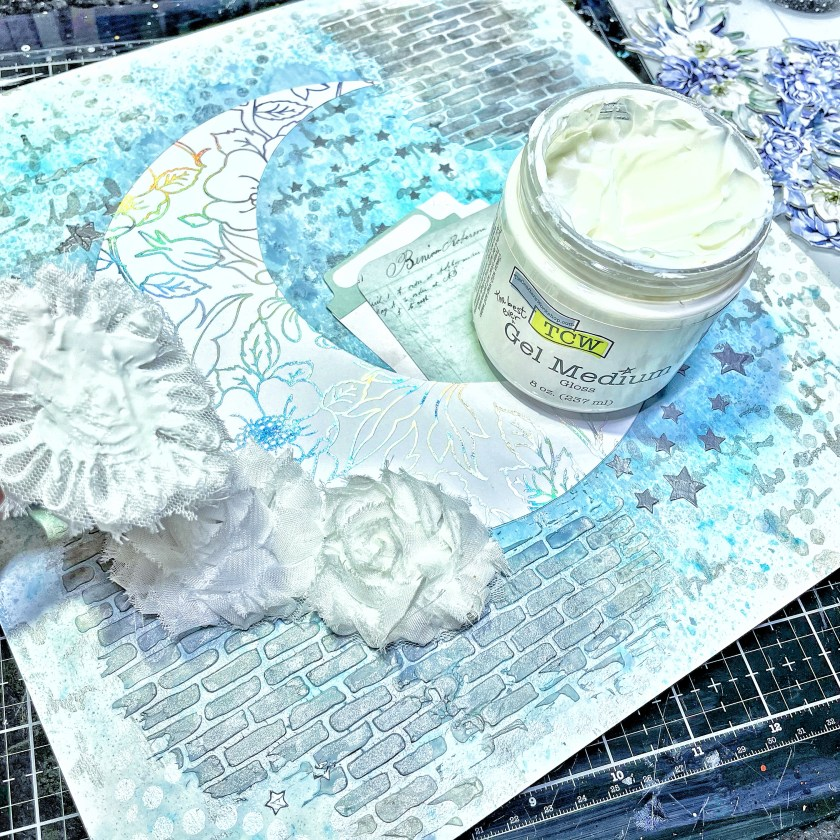 generous layer of TCW9006 Gel Medium Gloss with a palette knife on the back of floral embellishments