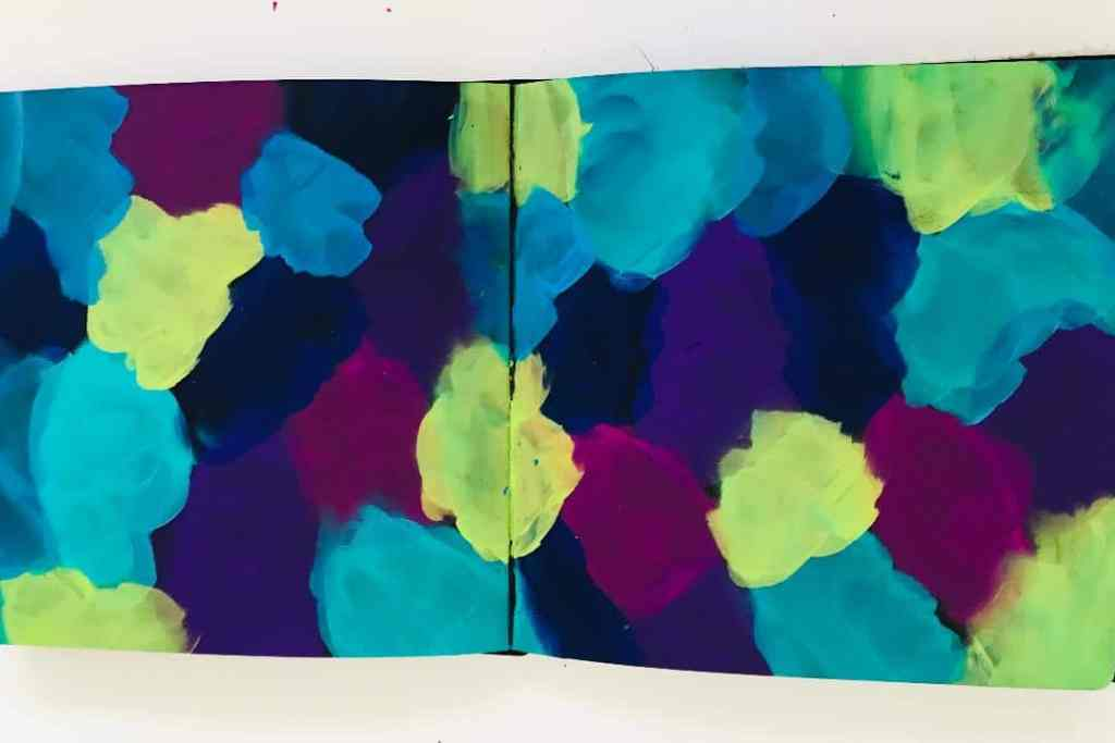 background paint patches in blue, lime, aqua, purple,pink