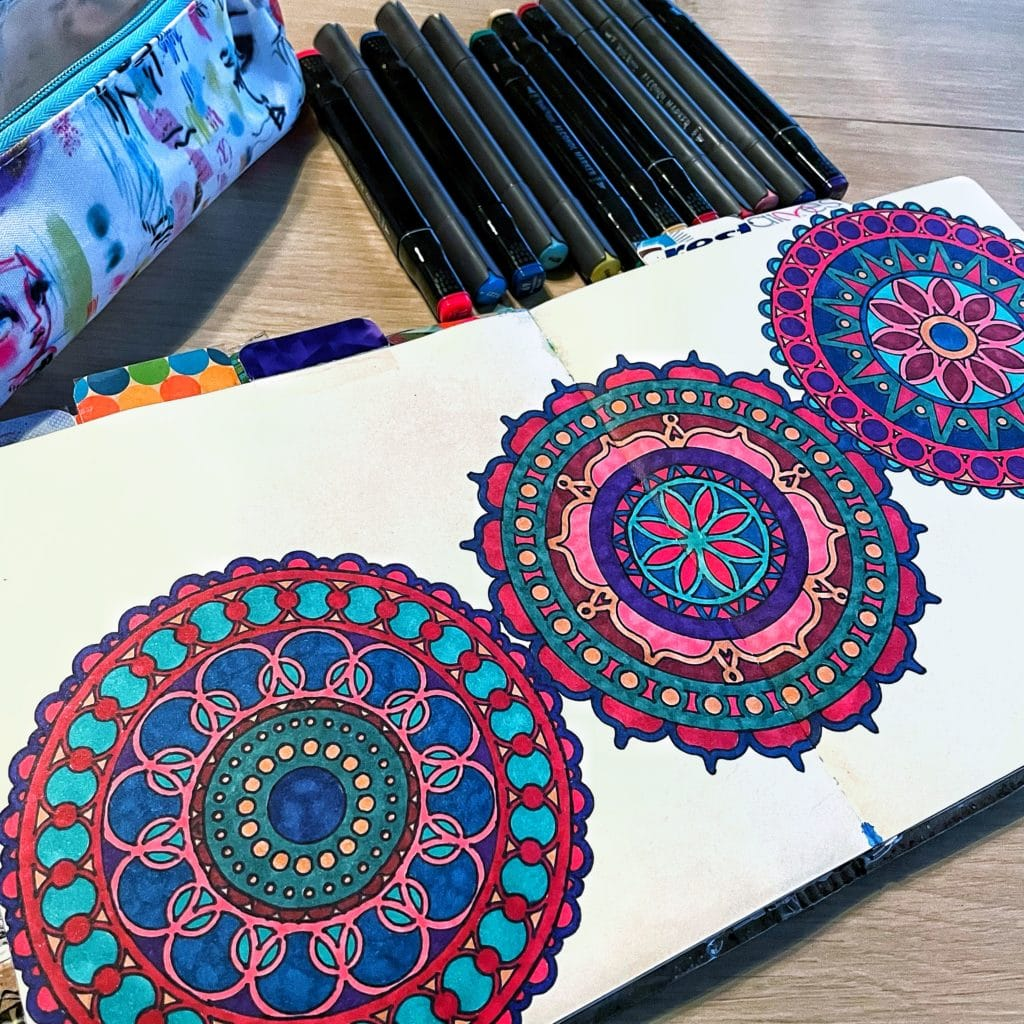 stenciled mandalas colored in with alcohol markers