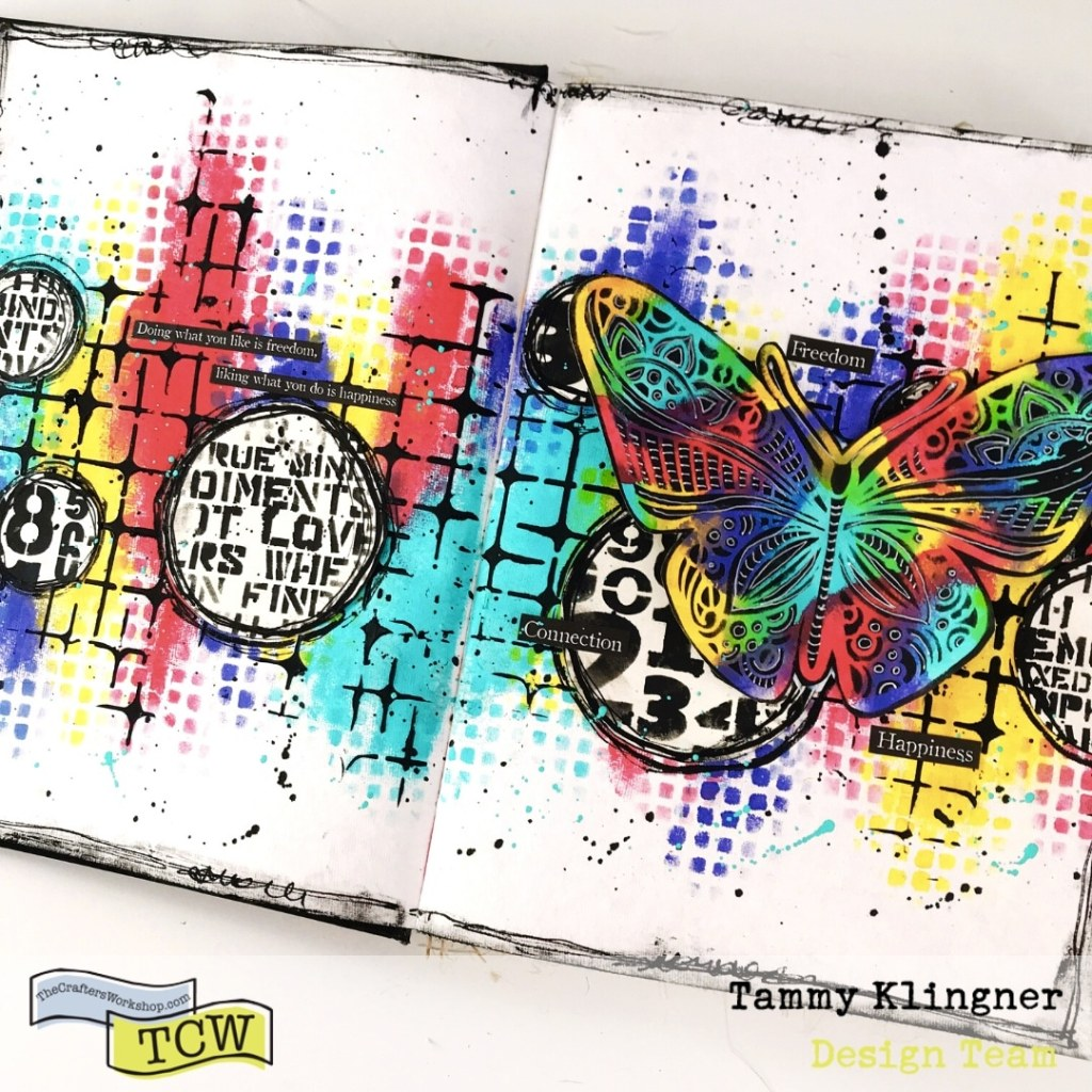 Art journal page with purple, red, yellow and aqua with a grunge background and rainbow butterfly
