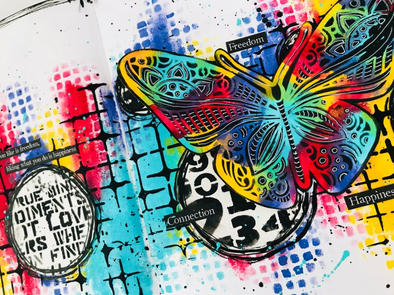 colorful art journal page with a rainbow butterfly