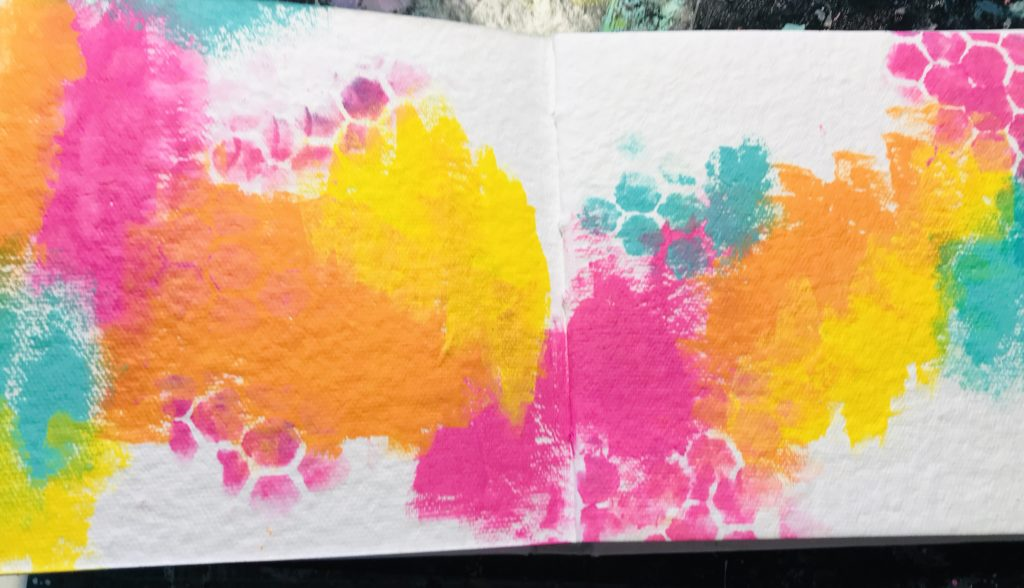 pink, orange, yellow and aqua paint for background