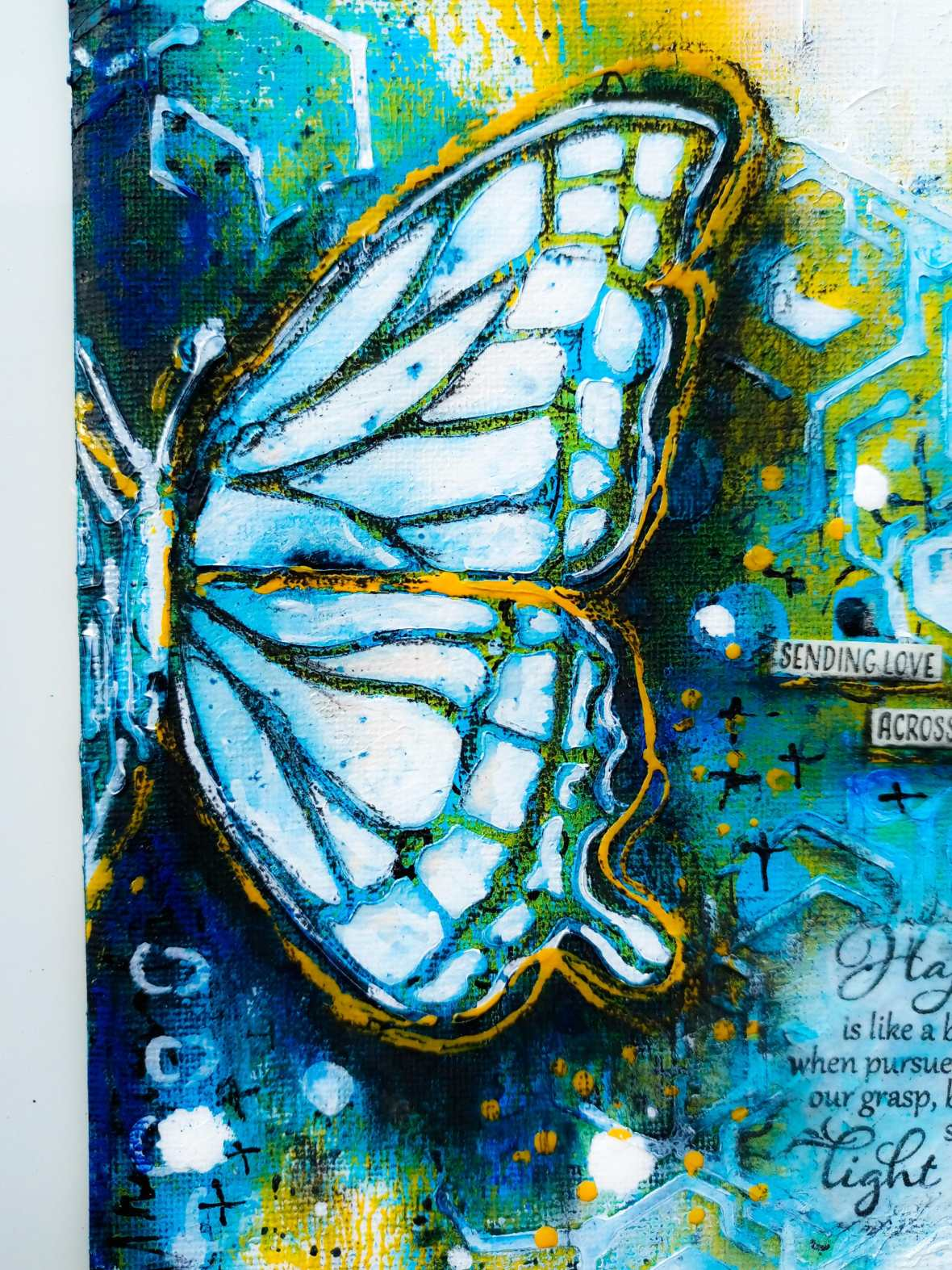 Close up view of a mixed media journal page